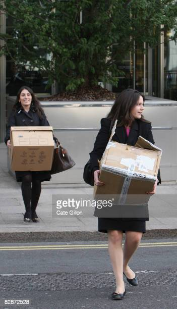 Two female employees leave Lehman Brothers' Canary Wharf office carrying belongings on September 15, 2008 in London, England. The fourth largest...