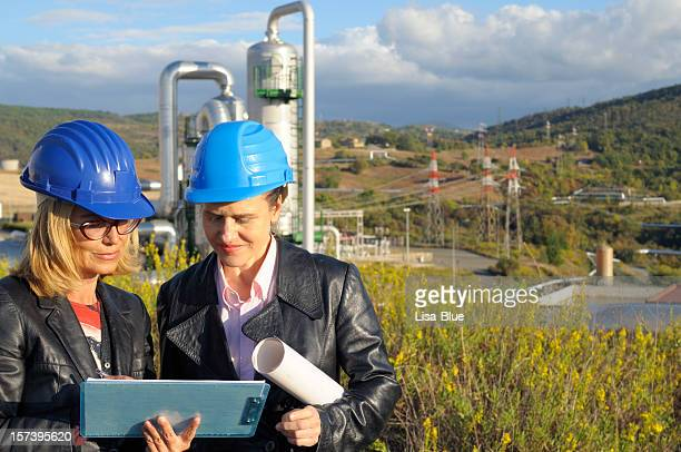 two female engineers planning in a geothermal power station - geologi bildbanksfoton och bilder