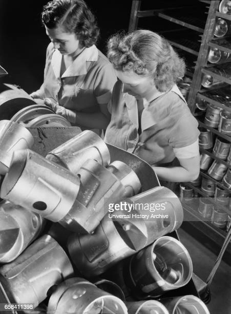 Two Female Factory Workers at Aluminum Foundry Converted to War Production Cincinnati Ohio USA Alfred T Palmer for Office of War Information February...