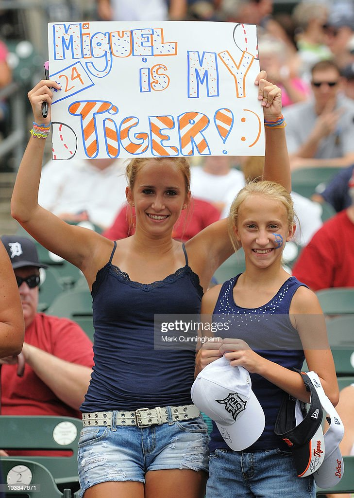 Two female fans hold up a sign of support for Miguel Cabrera #24 of the Detroit Tigers before the game against the Tampa Bay Rays at Comerica Park on August 11, 2010 in Detroit, Michigan. The Tigers defeated the Rays 3-2.