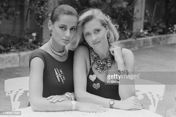 Two female fashion models wearing necklaces, bracelets and brooches by Yves Saint Laurent, UK, 13th July 1984.