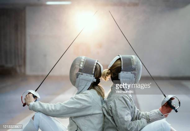 two female fencer's - face guard sport stock pictures, royalty-free photos & images