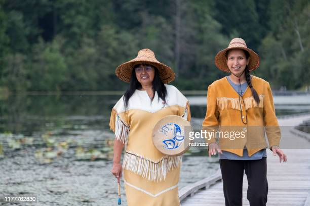 two female first nations dressed in traditional clothing. - inuit canada stock pictures, royalty-free photos & images