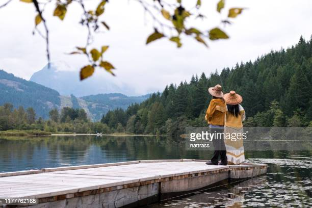 two female first nations dressed in traditional clothing singing - first nations stock pictures, royalty-free photos & images