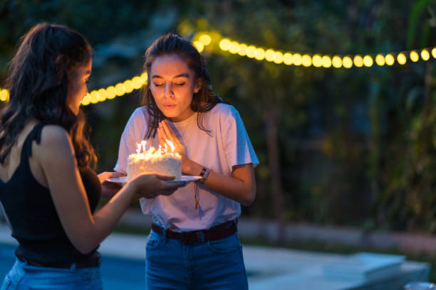 two female friends celebrating birthday party - best friend birthday cake stock pictures, royalty-free photos & images