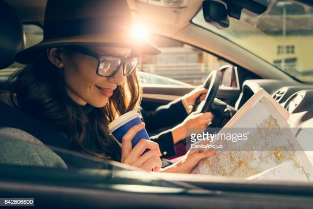 two female friends enjoying their road trip