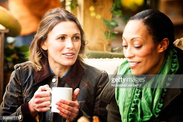 Two female friends having coffee at cafe