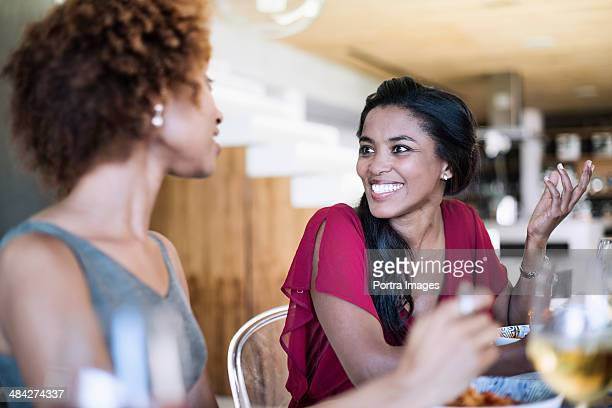 two female friends having dinner - female friendship stock pictures, royalty-free photos & images