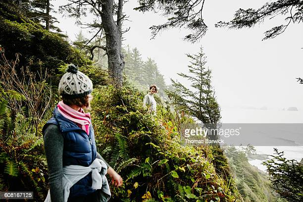 Two female friends hiking along bluff