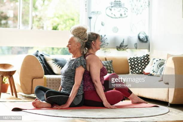 two female friends practising acroyoga - leaning disability stock pictures, royalty-free photos & images