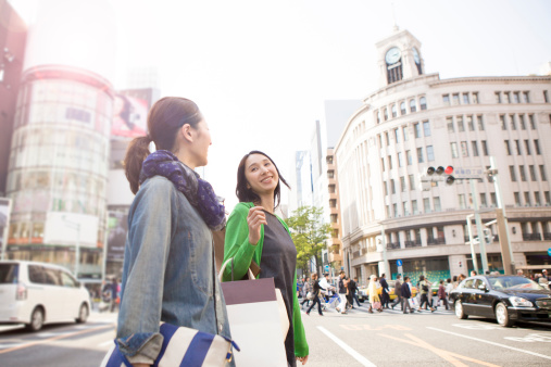 two female friends walking with shopping bags - gettyimageskorea