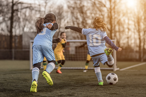 Two Female Girl Soccer Teams playing a football training match in the Spring outdoors 923185900