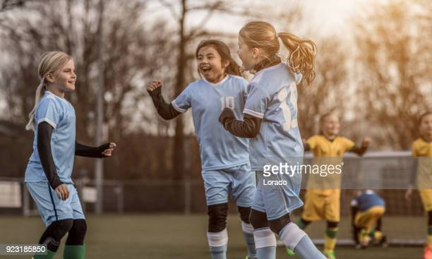 two female girl soccer teams playing a football training match - scoring a goal stock pictures, royalty-free photos & images