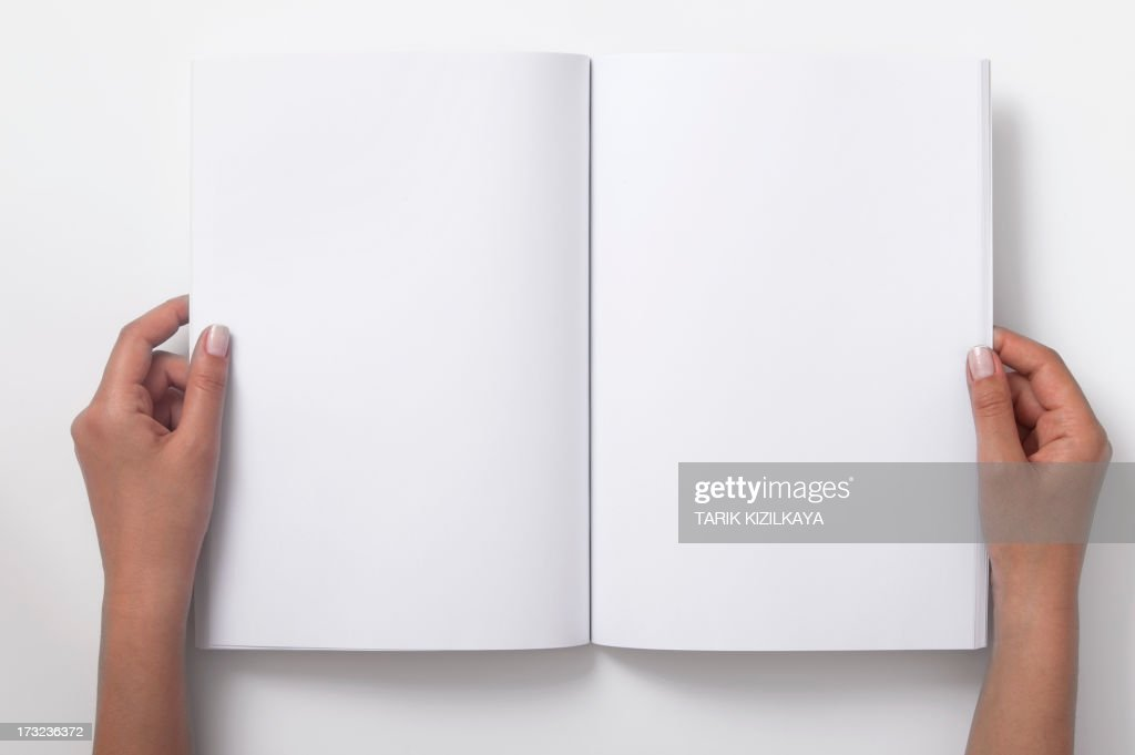 Two Female Hands Holding Open A Blank Magazine : Stock Photo