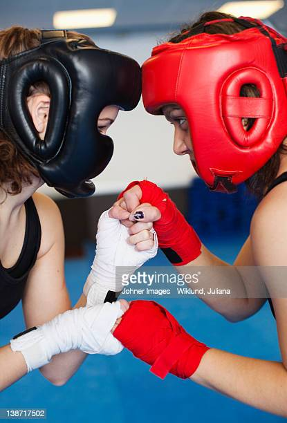 Two female kick boxers face to face