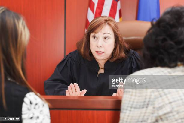 Two female lawyers at a female judges bench
