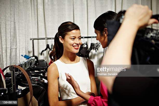 Two female models backstage at a fashion show