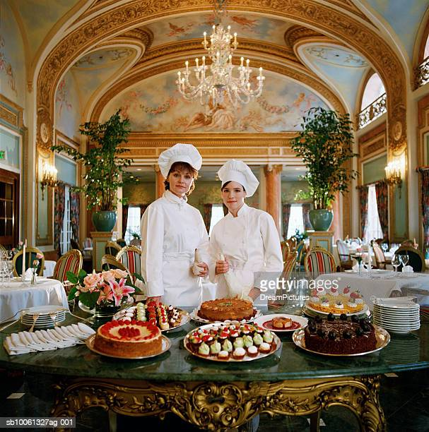 Two female pastry chefs, portrait