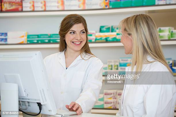 Two female pharmacists communicating
