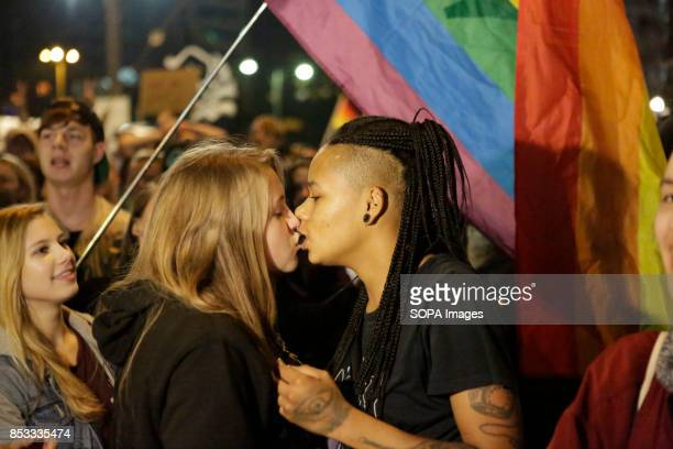 Two female protesters kiss under a rainbow flag Hundreds of protesters gathered outside a club near the central Alexanderplatz in Berlin that was the...