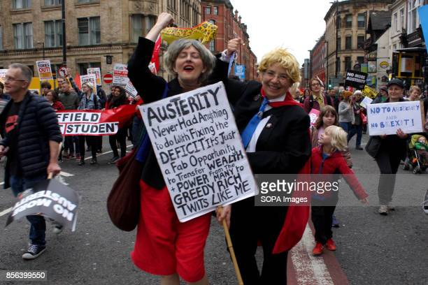 Two female protestors dressed as Prime Minister Teresa May and Foreign secretary Boris Johnson shout slogans during Conservative Party protests that...