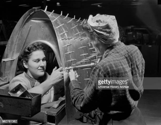Two Female Riveters Working on B17F Heavy Bomber Boeing Seattle Washington USA Andreas Feininger for Office of War Information December 1942