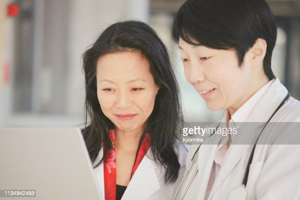 Two female scientist and doctor check the result