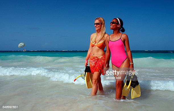 Two female scin diver on the beach, Punta Cana, Caribbean, Dominican Republic