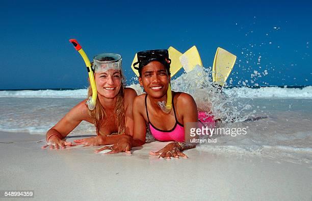 Two female scin diver on the beach, Punta Cana, Caribbean, Dominican Republic
