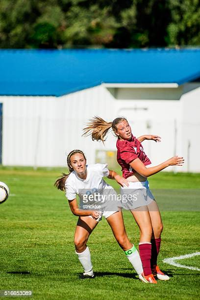 Two Female Soccer Players Watch Headed Ball Result