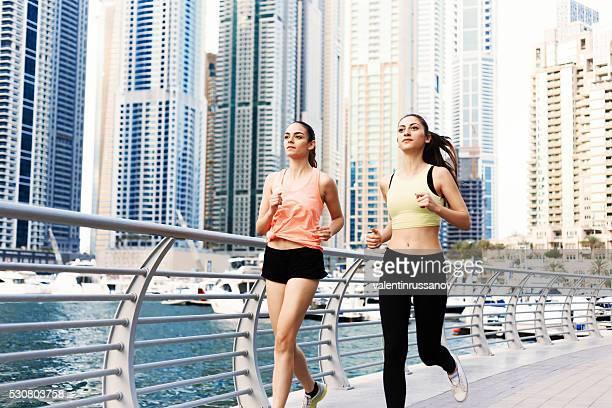 Two female sprinters doing jogging in Dubai Marina