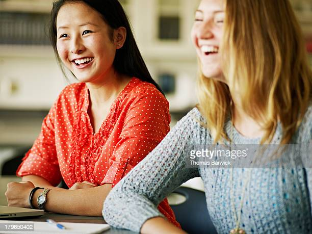 Two female students studying together in classroom