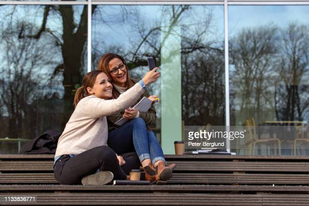 Two female students taking selfies