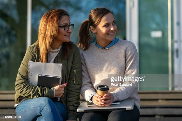 Two female students talking