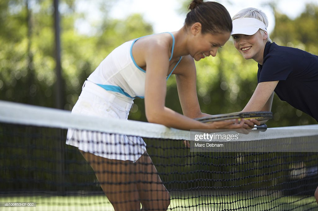 Two female tennis players at net on outdoor court : Foto stock