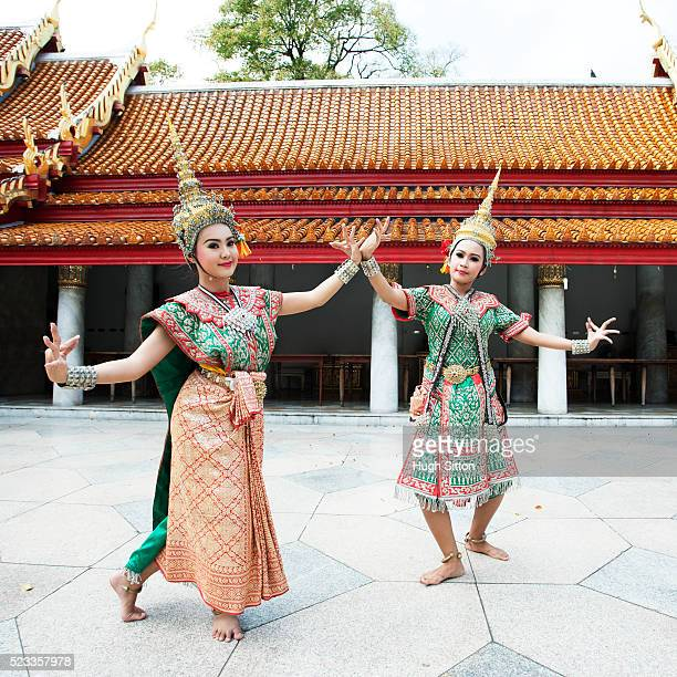 Two female Thai dancers in traditional costume