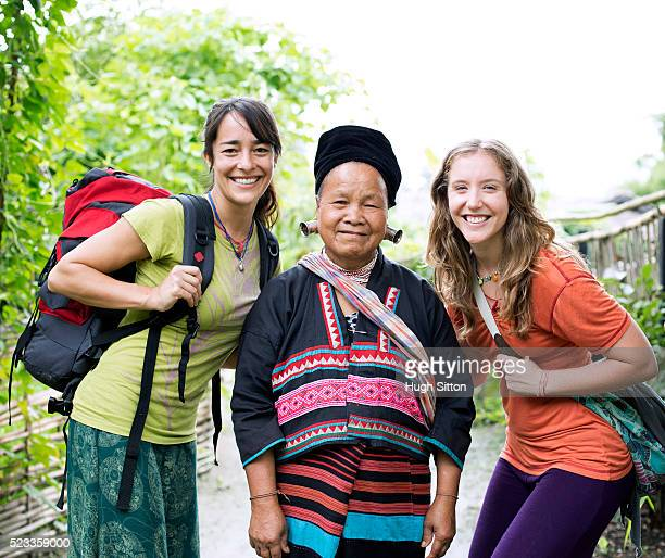 two female tourists and local woman, chiang mai, thailand - hugh sitton stock pictures, royalty-free photos & images