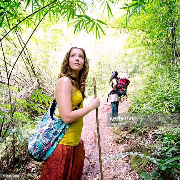 Two female tourists exploring rainforest