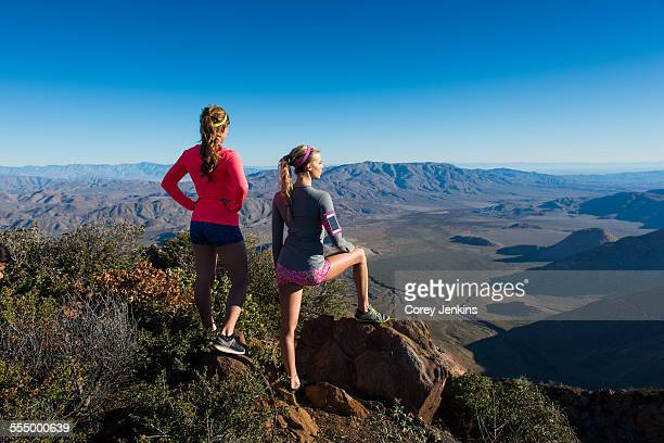 two female trail running friends looking out over landscape on pacific crest trail, pine valley, california, usa - pacific crest trail stock pictures, royalty-free photos & images