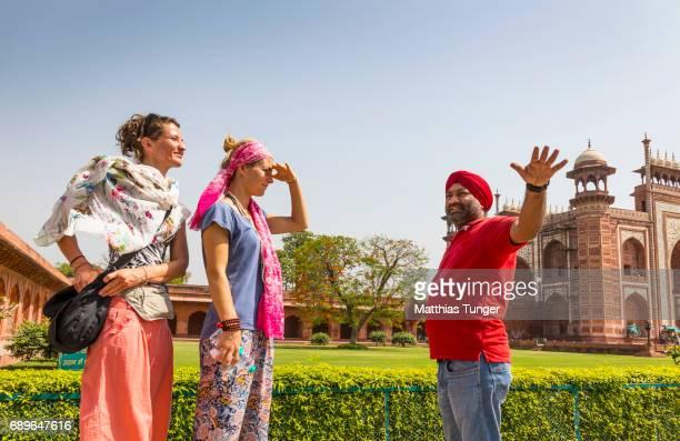 two female visitors on a tour at the Taj Mahal