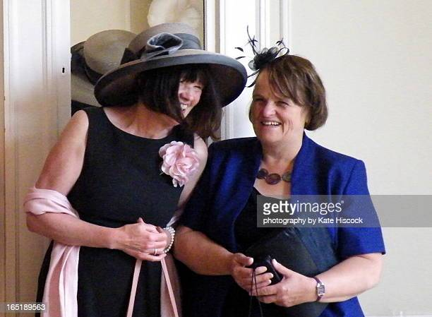 two female wedding guests happy and  giggling