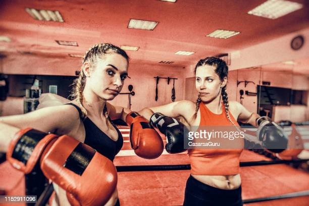 two females chatting after martial arts training - women's boxing stock pictures, royalty-free photos & images