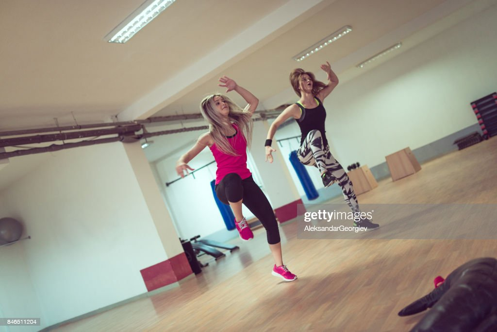 Two Females Dancing Zumba and Fitness Training in Tights in Gym : Stock Photo