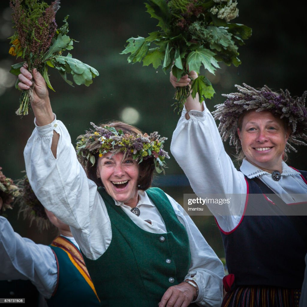 Two females dressed in national costumes : Stock Photo