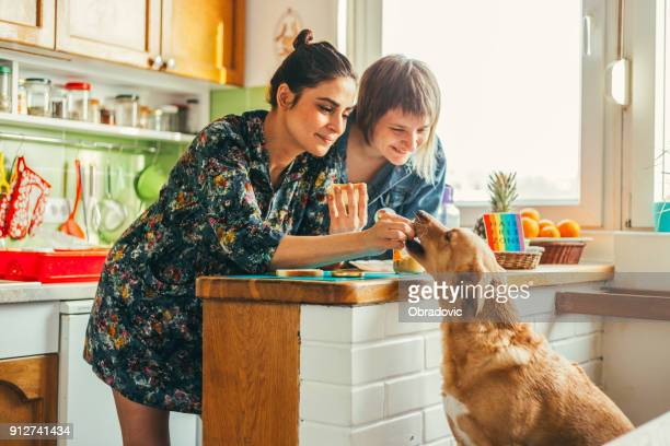 two females enjoing breakfast at home - lgbtq  and female domestic life stock pictures, royalty-free photos & images