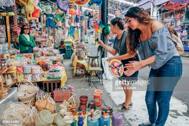 Two females shopping together in Market