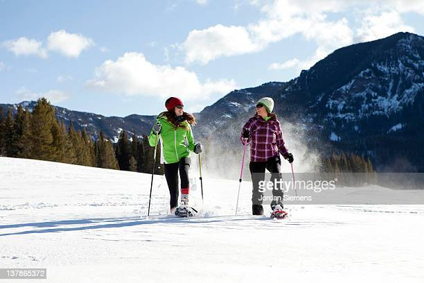 Two females snowshoeing
