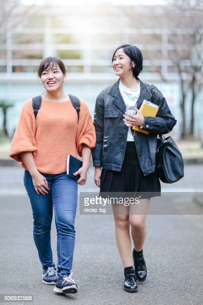 two females students walking to lesson - japanese short skirts stock pictures, royalty-free photos & images