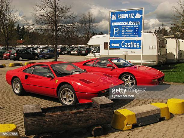 Two ferrari cars on a parking area near castle Neuschwanstein on September 24 2008 in Hohenschwangau Ostallgaeu Germany The castle was rebuilt by the...