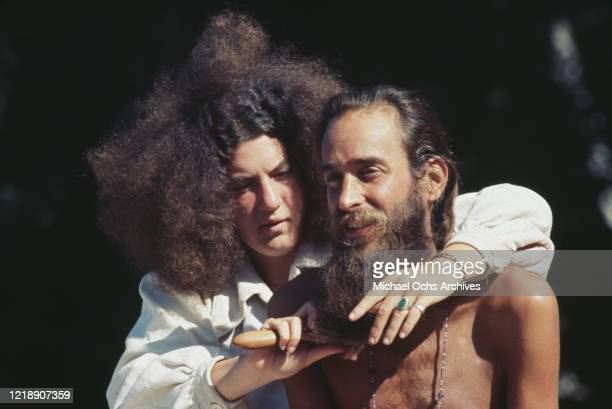 Two festivalgoers with a woman brushing a man's beard at 'Vortex I A Biodegradable Festival of Life' a weeklong rock festival held at Milo McIver...